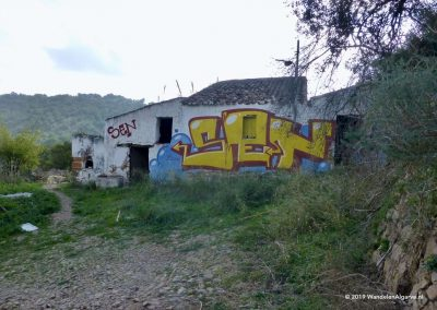 On the hill side of the Asseca river a ruin filled with modern graffiti